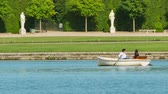 paryż : VERSAILLES, FRANCE - JUNE 08, 2017: People boating on the Grand Canal of the Palace of Versailles in France. The Palace of Versailles is a royal chateau in Versailles, France. Wideo