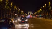 french street : PARIS, FRANCE - JUNE 10, 2017: A trafic on Chaps Elysees at night with triumphal arch on background Stock Footage