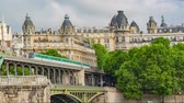 trafik : PARIS FRANCE, JUNE 12, 2017: Metro train on the pont de Bir Hakeim bridge Stok Video