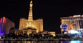 aposta : LAS VEGAS, NEVADA - JANUARY 03, 2018: Bellagio fountain at night with a Paris hotel and Ballys hotel view on background