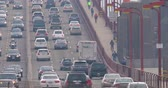 red traffic light : SAN FRANCISCO - DECEMBER 23, 2017: Heavy traffic on Golden Gate Bridge, connecting San Francisco to Marin County, close-up view