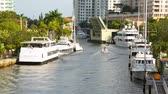 Boat passing rised drawbridge in Fort Lauderdale, Florida.