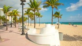 People having a rest on the Fort Lauderdale beach and walking on seafront. Stock Footage