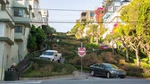 russian city : SAN FRANCISCO, USA - DECEMBER 22, 2017: Vehicles moving down the Lombard street that consists of eight tight hairpin turns.