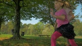 wide : Slow motion shot of two adorable children running along playground