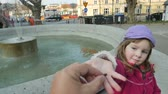 opportunities : Cute little girl throw a coin into Fountain for good luck Stock Footage