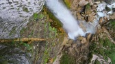perfection : Mid air view of a large waterfall with rocks and wild landscape. Stock Footage