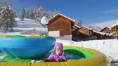 śnieżka : Hidden little girl stands up and throws a snowball Wideo