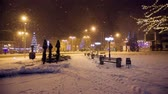 christmass : Snow falls in a christmass city Stock Footage