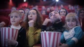 auditório : People eating popcorn and grimacing at cinema Vídeos