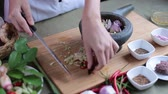 тмин : A female hand put many kinds of Thai herbs in mortar and pulverize to make Thai red curry chili paste or Panang.