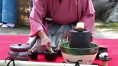 quimono : Japanese man in traditional kimono prepares the tea ceremony at garden of the Hagiwara Temple