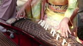 quimono : Japanese woman playing the traditional koto Japanese traditional instrument