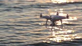 brilho : Remote controlled drone flying sparkle sunlight on sea