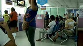 inceleme : PATTAYA, THAILAND - October 30, 2012. People waiting for driving test in police station. Stok Video