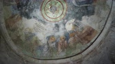 fresk : Fresco on the dome of the altar, scene of the communion. Jesus Christ gives his apostles bread and wine. Saint Nicholas church in Demre, Turkey. Stok Video