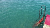 ondas : Rusty stairs from pontoon into water. Mediterranean sea. Kemer, Turkey. Stock Footage