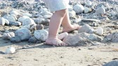 csupasz : Baby playing with stones on beach. Kids hands full with sand. Outdoor games.