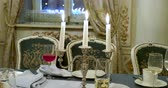 latarnia : Burning candles in metal candle holder. Table served for dinner. Beautiful interior detail for party at night.