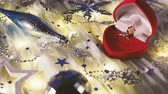 подарки : Christmas and New Year background with holiday decoration and diamond engagement ring in red heart gift box.