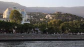 RUSSIA, YALTA - February 4, 2015. Panorama view of Yalta town from the Black sea. Winter sunset. Crimea.