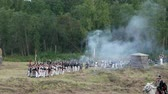 espada : BORODINO, RUSSIA - September 02, 2017 - Reenactment of the battle of Borodino (the Patriotic war of 1812 year). Tourists watch the performance from from the fenced places.
