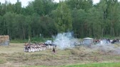cavaleiro : BORODINO, RUSSIA - September 02, 2017 - Reenactment of the battle of Borodino (the Patriotic war of 1812 year). Tourists watch the performance from from the fenced places.