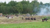 BORODINO, RUSSIA - September 02, 2017 - Reenactment of the battle of Borodino (the Patriotic war of 1812 year). Tourists watch the performance from from the fenced places.