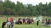 espada : BORODINO, RUSSIA - September 02, 2017 - Reenactment of the battle of Borodino the Patriotic war of 1812 year . Tourists watch the performance from from the fenced places. Vídeos