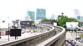 mrt : Kuala Lumpur, Malaysia - December 31st 2017: Kuala Lumpur heavy traffic pack with cars with Monorail train moving above traffic during rush hour near Monorail or train on a city road Stock Footage
