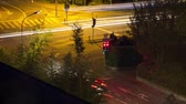 intersection : Night time traffic at a traffic lights timelapse
