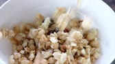 диеты : Pouring cereals into a white bowl. Slow motion.