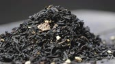 Rotating loose earl grey black tea leaves. Stock Footage