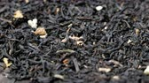 Rotating loose earl grey black tea leaves. Stok Video