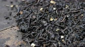 kräutertee : Rotierende lose Earl Grey Black Teeblätter. Stock Footage