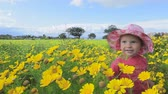 Small child playing in a meadow full of flowers. Near Mar Menor lagoon. Spain.  Clip 1b.