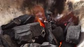 kindle : Licking flame from fire charcoal in thai traditional stove with pine stick