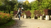 bolsa : Woman walking at park, 4K ProRes HQ codec