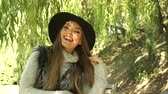 salgueiro : Woman outdoor. Fashionable autumn girl long hair wearing fur vest black hat enjoy nature. Joyful female model relaxing in park. 4K Prores HQ codec