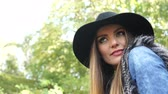 Woman outdoor. Fashionable autumn girl long hair wearing stylish black hat enjoy nature. Beauty female model relaxing in park. 4K Prores HQ codec Stock Footage
