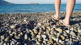 human back : Woman walking to water on beach, back view Stock Footage