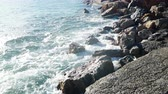 Sea waves and stone rocky shore