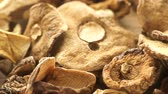 Food. Dry mushrooms on wooden surface table background.