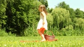 Summer. Little girl dancing on the meadow. Cute child having fun in the park.