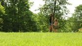 domingo : Summer. Young woman with her little daughter girl on a walk in the park, meadow or forest. Stock Footage