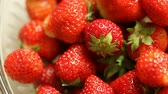diety : Fresh ripe strawberries seasonal fruits in glass bowl as food background. Full HD with motorized slider. 1080p. Dostupné videozáznamy