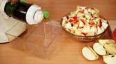 aparelho : Nobody. Apple fruits whole and sliced and juicer machine in kitchen prepared to make fresh juice. Healthy eating, vegetarian food, dieting. Dolly slider shot 4K ProRes HQ codec Stock Footage
