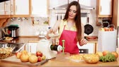 toranja : Woman young housewife in kitchen making fresh orange juice in juicer machine, preparing nutritious vitamin packed drink. Healthy eating, vegetarian food, dieting and people concept. 4K ProRes HQ codec