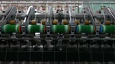 tekercs : Machinery and equipment in the workshop for the production of thread, closeup. interior of industrial textile factory. the camera is stationary