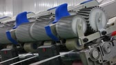 stationary : Machinery and equipment in the workshop for the production of thread, closeup. interior of industrial textile factory. the camera is stationary